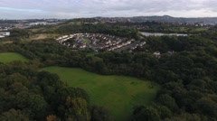 Aerial shot of a housing estate surrounded by woodland. Stock Footage
