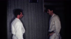 1967: learning to block punches in a karate dojo. LOS ANGELES CALIFORNIA Stock Footage