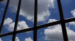 Dolly shot of view trough prison window. Stock Footage