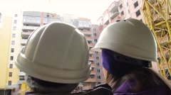 Young male engeneers workers foreman at a indoors building site Stock Footage