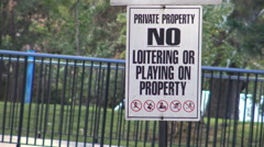 No Loitering or Playing on Private Property Signage Stock Footage