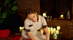 Woman lying on wooden massage spa bed. 4k. Stock Footage