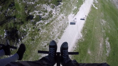 Sitting in chairlift cable hoist on bright summer day Stock Footage