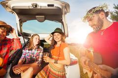 Young people having fun during a summer car trip Stock Photos