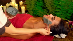 Massage and mud facial mask in spa salon. 4k. Stock Footage