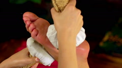 Young woman have hot foot poultice massage in spa salon. Slow motion. Stock Footage