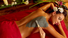 Massage and clay body mask in spa salon. Top view. 4k Stock Footage
