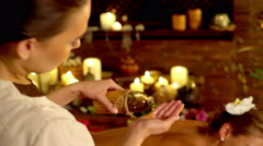 Masseuse pouring oil in his hand and begins to massage. 4k. Stock Footage