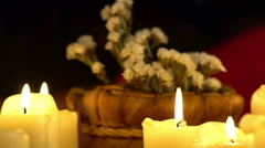 Still life with burning candles and massage herbs. Background girl gets massage. Stock Footage