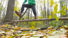 Men Jogging cross country And Jumping Over Obstacle running in forest. Traini Stock Footage