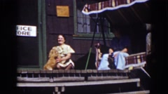 1939: couple of ladies sitting outside office store with blond cocker spaniel Stock Footage