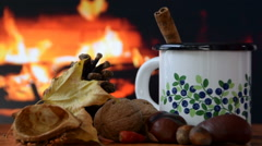Cup of warm drink by the fire Stock Footage