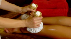 Young woman have hot foot poultice massage in spa salon. Stock Footage
