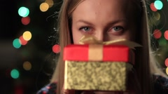 Happy young woman holding christmas present box Stock Footage