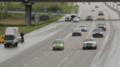 Road traffic on the streets of the modern metropolis Stock Footage