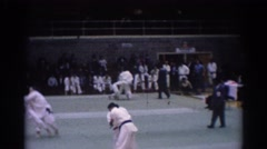 1967: opponents sparring at a karate competition. LOS ANGELES CALIFORNIA Stock Footage
