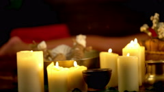 Still life with burning candles and massage herbs. 4k. Stock Footage