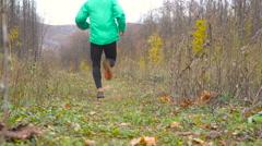 Sport Man jogging cross country running. Training and exercising outdoors whe Stock Footage
