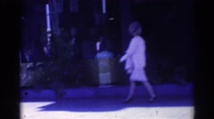 1967: woman in suit walks by storefronts LOS ANGELES CALIFORNIA Stock Footage