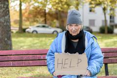 Homeless or poverty stricken elderly lady Stock Photos