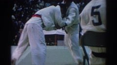 1967: two guys going at it in karate, both trying to knock each other down  Stock Footage