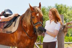 Friendship of beautiful young woman and bay horse Stock Photos