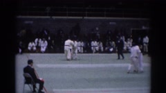 1967: historic footage of karate type wrestling match with three groups of two Stock Footage