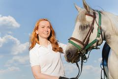 Portrait of pretty smiling woman with white horse Stock Photos