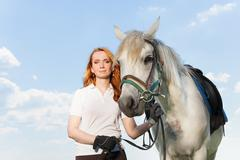 Beautiful picture of young woman with white horse Stock Photos