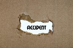 The word accident appearing behind torn paper Stock Photos