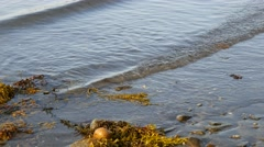 Rippling waves washing ashore close view Stock Footage