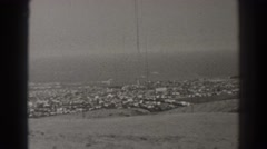 1937: black and white archive footage of camera panning over view of suburb  Stock Footage