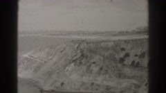 1937: black and white, aerial, panoramic view of coastline LONG BEACH CALIFORNIA Stock Footage