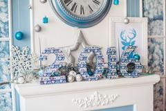 Christmas decor, fireplace and Christmas tree Stock Photos