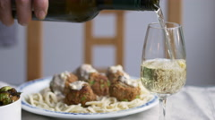 Serving white wine with food Stock Footage