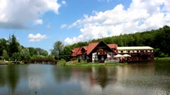 Traditional Buildings On Lake Island On Sunny Day Stock Footage