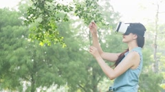 Beautiful asian woman simulation in outdoor forest. VR virtual reality headset Stock Footage