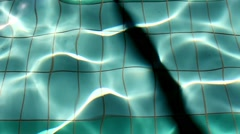 Bottom Of Swimming Pool And Reflecting Sun Stock Footage