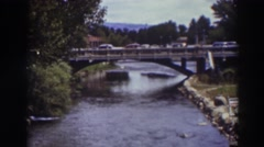 1937: panoramic view of cars passing a bridge over a river TRUCKEE CALIFORNIA Stock Footage