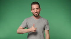 Hipster man in a gray shirt  showing thumb up Stock Footage