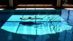 Man Swimming Underwater Breaststroke In Luxurious Swimming Pool Stock Footage