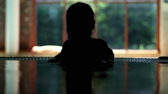 Little Girl Silhouette In Jacuzzi Spa Stock Footage