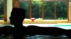 Man Relaxing In Jacuzzi Spa Stock Footage