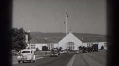 1938: cars driving down a street in front of a church BONNEVILLE DAM OREGON Stock Footage