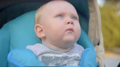 One years old baby boy sneezing in the pram. Close-up. Slow Motion Stock Footage