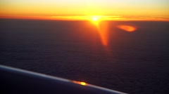 Airplane flying over clouds with a sunset, Stock Footage