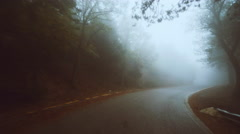 Pov driving on foggy dark scary mountain road at winter Stock Footage