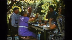 1939: several senior couples share an afternoon meal on an outdoor table AUBURN Stock Footage