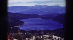1937: a beautiful lake set right in the middle of the wild wood. LAKE TAHOE Stock Footage