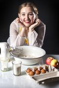 Smiling homemaker in kitchen Stock Photos